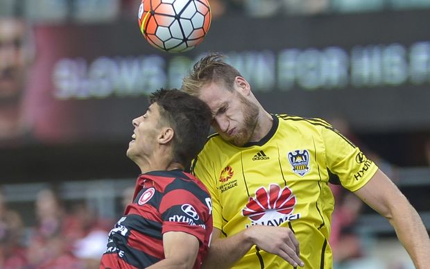 Hamish Watson (right) battles for a header against Western Sydney Wanderers.