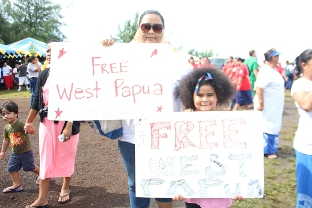 "Valerie Adams and her 7-year-old daughter demonstrating support for a ""Free West Papua"" to coincide with a visit to Pago Pago by the Indonesian Ambassador to the US."