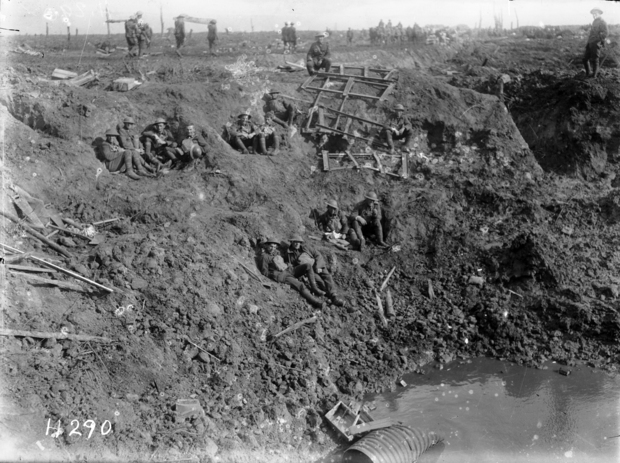 New Zealand Engineers resting in a large shell hole at Spree Farm, Ypres Salient, Belgium, 12 October 1917.