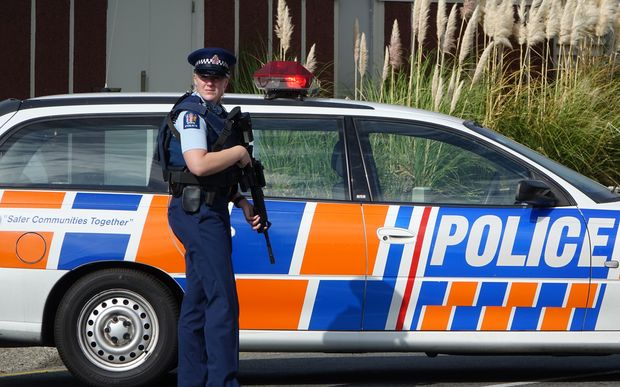 Police have evacuated residents of a Porirua street, north of Wellington, as they hunt for an armed offender who shot dead a police dog.