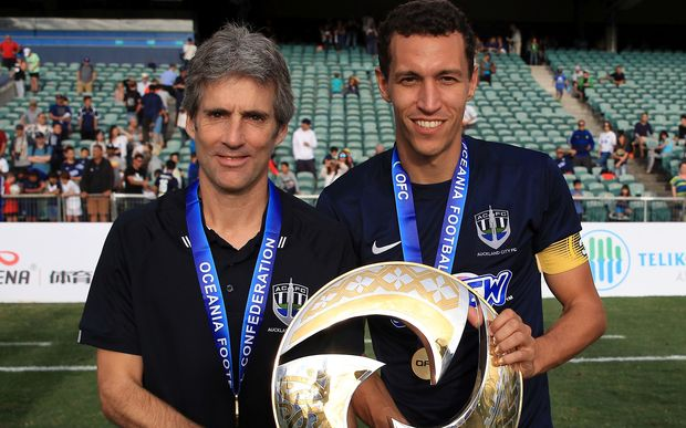 Auckland City coach Ramon Tribulietx and captain Angel Luis Viña Berlanga pose with the OFC trophy.