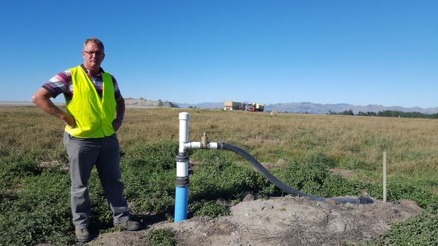 Christchurch City Council's landfill aftercare officer, Grant Gillard, checks out one of the current gas wells at the Burwood Landfill site.