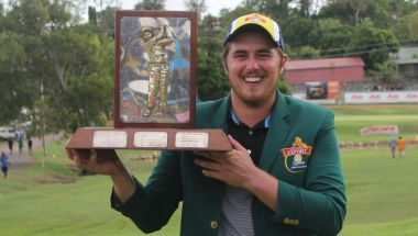 Brad Moules holds aloft the PNG Open trophy.