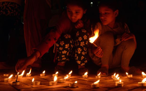 Nepalese residents gather in Durbar Square in Kathmandu to mark the first anniversary of the devastating earthquake.
