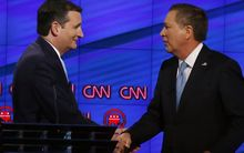 Texas Senator Ted Cruz, left, and Ohio Governor John Kasich shake hands following a CNN debate on 10 March in Miami.
