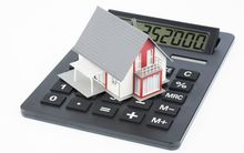 House on calculator (stock)