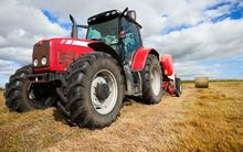 Tractor, hay bales on farm (stock photo)