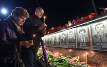 People light candles at the monument to Chernobyl victims in Slavutich, about 50km from the accident site, and where many of the power station's personnel used to live on the 30th anniversary of the disaster.