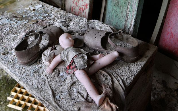 "A doll and shoes lay on a bench in a nursery school of the ""ghost town"" of Pripyat."