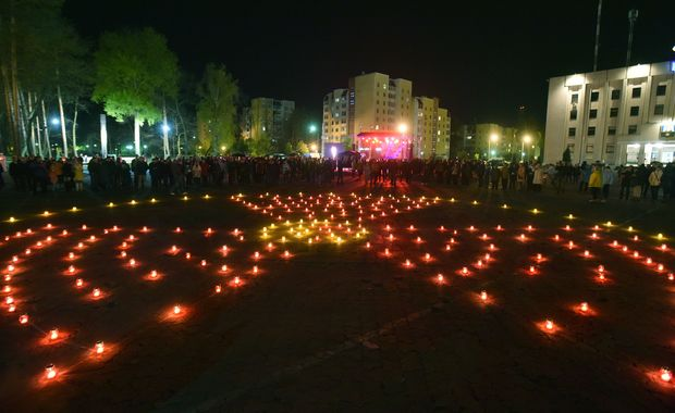 Candles are lit in the shape of a radiation hazard symbol on the 30th anniversary of the Chernobyl disaster.