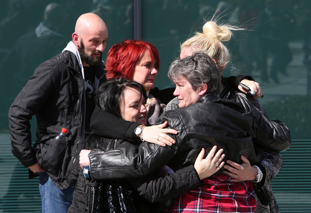 Relatives react the coroner's court in Warrington, north-west England.