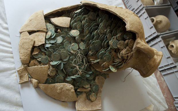 A Roman era amphora filled with bronze coins is displayed at the archaeological museum in Seville.