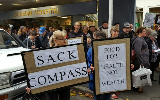 Protesters want the 15-year contract with Compass to be scrapped.