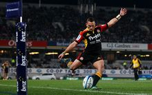 Chiefs' Aaron Cruden kicks a conversion.