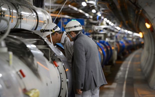 Scientists inspect the inner workings of the Large Hadron Collider.