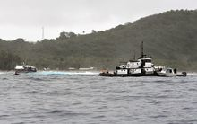 Vessel remains stuck on American Samoa reef.
