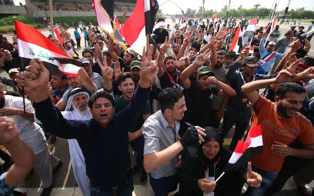 Iraqi protesters in the parade grounds outside the parliament in Baghdad's heavily fortified Green Zone.