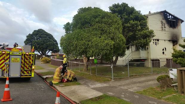 The damage from the suspected arson at a house at the centre of the Porirua siege.