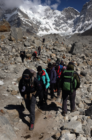 Trekkers and climbers make their way up and down a trail leading to Everest Base Camp on 24 April, 2015.