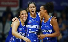 Northern Mystics players Nadia Loveday, Kayla Cullen and Serena Guthrie celebrate a win 2016.