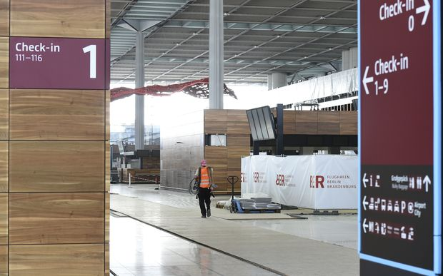 A construction worker in the uncompleted Berlin Brandenburg airport, which was originally expected to open five years ago.