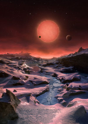 An artist's impression showing the possible view from the surface one of the three planets orbiting an ultracool dwarf star just 40 light-years from Earth.