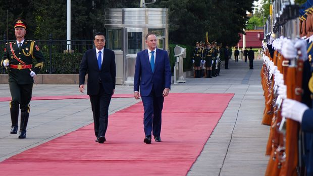 Prime Minister John Key walks up the red carpet as he is officially welcomed by Premier Li Keqiang at the Great Hall of the People, Beijing.