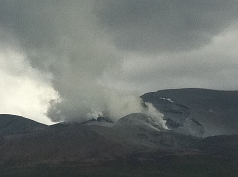 A tower of steam and ash rises from the latest eruption at Te Maari craters.
