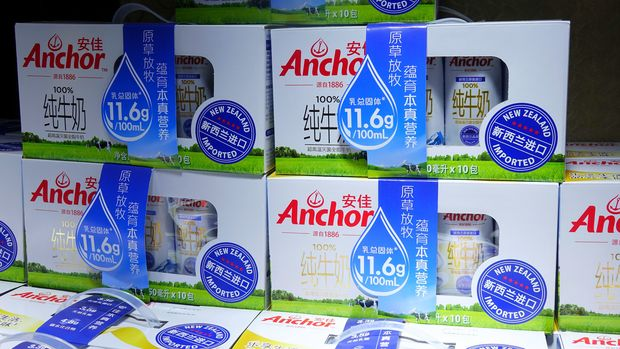 Anchor milk with Chinese writing on packages being sold at a Beijing market