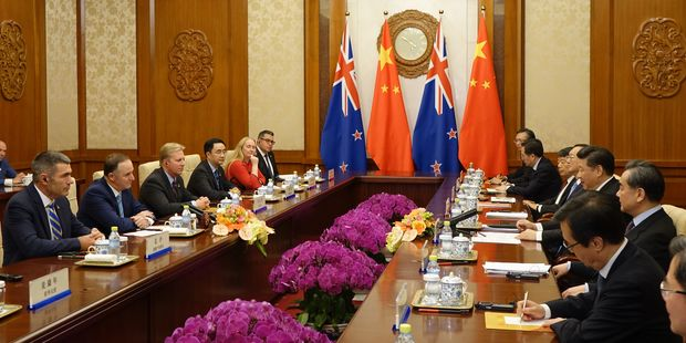 John Key and President Xi hold talks in the wood-pannelled Diaoyutai State Guesthouse in Beijing. The flags of China and New Zealand hang above the two parties seated at long tables opposite each other