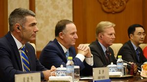Primary Industries Minister, Nathan Guy, sits alongside the Prime Minister, the Trade Minister and National MP Jian Yang during talks with President Xi, Beijing.