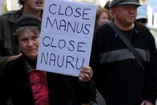 Street marcher with sign calling for closure of Nauru and Manus island detention center during World Refugee Rally June 20, 2015 in Brisbane, Australia.