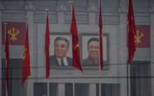 Portraits of late North Korean leaders Kim Il-Sung and Kim Jong-Il on the 'April 25 Palace', the venue of the 7th Workers Party Congress in Pyongyang.