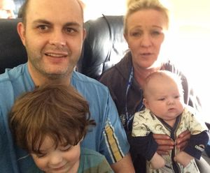 New Zealand man Craig Rowland and his wife and small children are in Calgary waiting to hear if their home has burnt to the ground after fleeing a wildfire in Alberta.