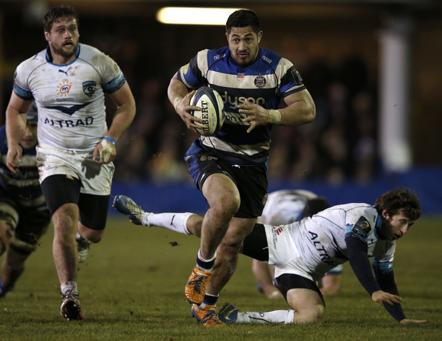 Bath's Samoan flanker Alafoti Faosiliva (centre) makes a break during the European Rugby Champions Cup rugby union match between Bath and Montpellier at the Recreation Ground in Bath, December 12, 2014.