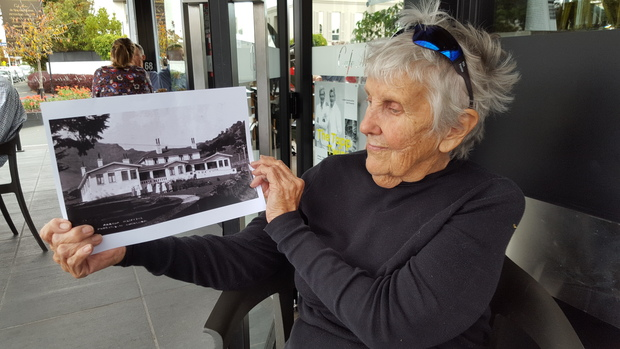 Akaroa resident Gloria Calcutt with  a photo of the former Akaroa Hospital, which she worked at as a nurse from 1977 to 2010.