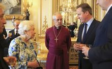British PM David Cameron talks to Queen Elizabeth II.
