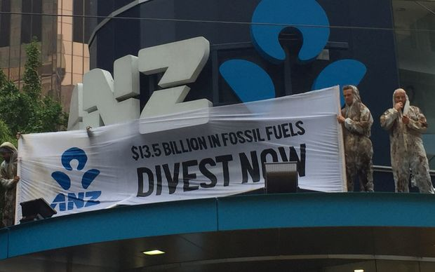 Protesters unfurled a banner on the ANZ building in central Wellington.