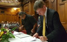 Lead Negotiator Jason Kerehi and Minister for Treaty of Waitangi Negotiations Christopher Finlayson, initialling the Deed of Settlement.