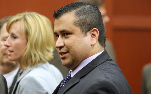 George Zimmerman leaves the courtroom a free man after being found not guilty, on the 25th day of his trial at the Seminole County Criminal Justice Center July 13, 2013 in Sanford, Florida.