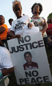 Protesters demonstrate at a rally for slain teenager Trayvon Martin on March 22, 2012 in Sanford, Florida.