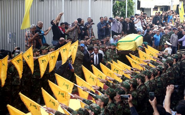 The coffin of Mustafa Badreddine, is being carried through the Hezbollah controlled Dahiyeh district of Beirut.