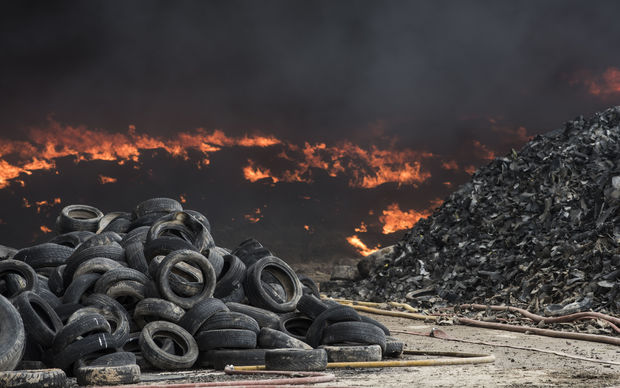Tyres burn in an uncontrolled dump near the town of Sesena, Spain, after a fire brokeout early on May 13, 2016.