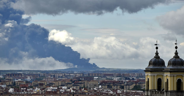 Picture taken from the Almudena cathedral in Madrid shows a huge smoke column caused by a fire in an uncontrolled dump near the town of Sesena,