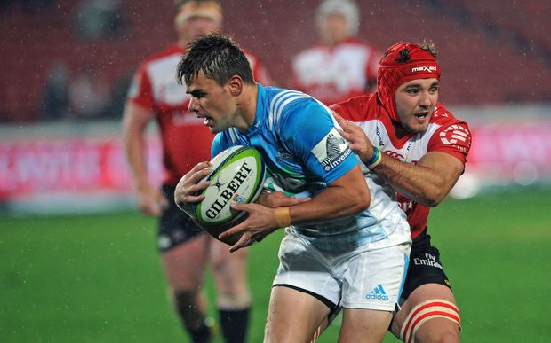Kyle Brink of Lions challenges Matt McGahan of Blues during the Super Rugby match between Lions and Blues on 14 May 2016 at Ellis Park Stadium.