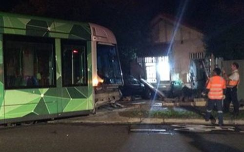 A Melbourne tram smashed into a home after colliding with a car.