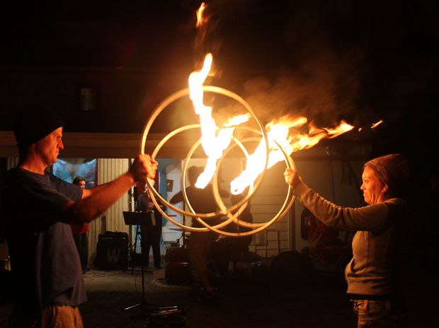 Concentration; Andy and Felicity and their  flaming bike wheel routine