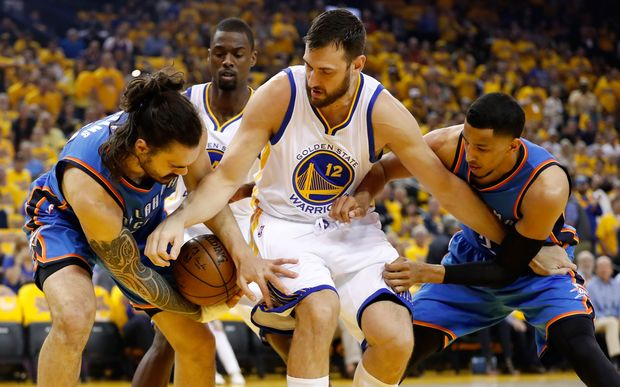 Steven Adams wrestles the ball off Golden State center Andrew Bogut.