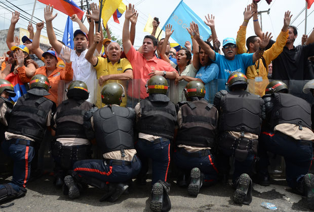 Police block protesters trying to reach the National Electoral Council on May 18, 2016 in Valencia, Venezuela.Police and protesters clashed across the country at nationwide rallies demanding a recall referendum of President Nicolas Maduro.