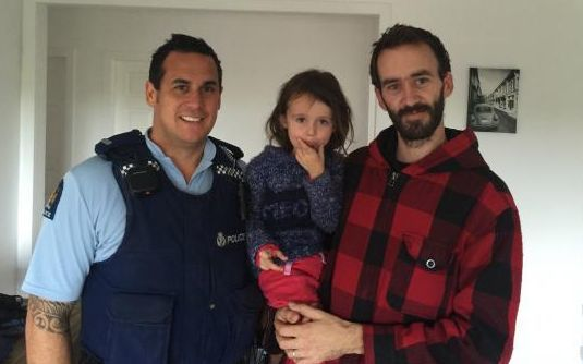 Sergeant Craig Curnow, left, with four-year-old Hailey Alver and father Chris Alver.